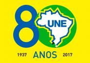 Logo-Une-80-fundo-verde-8-azul.png-AMARELO-VERTICAL